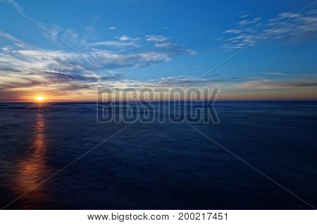 Sunset in Jastrzebia Gora Poland. Long time exposure make perfectly smooth sea.