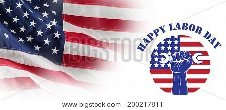 Happy labor day text over cropped hand holding tools against full frame of wrinkled american flag
