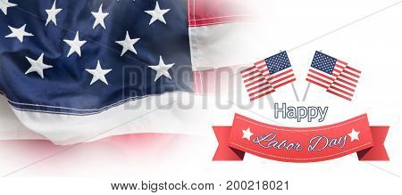 Happy labor day text badge with flags against full frame of wrinkled american flag