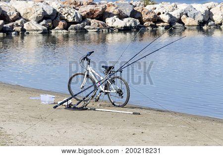 The bike and fishing rod on the beach