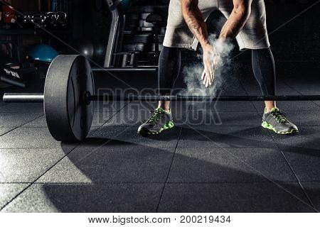 Young athlete getting ready for  training in gym