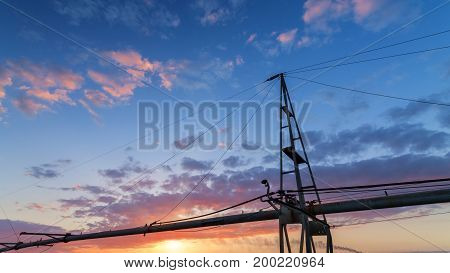 evening field irrigation / sprinkler system for the fields on the background of a sunset bright sky evening landscape
