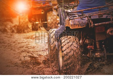 action shot of sport atv vehicle running in mud track