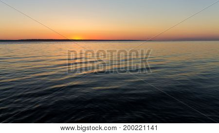 sunrise on the water Early summer morning bright sky Beach