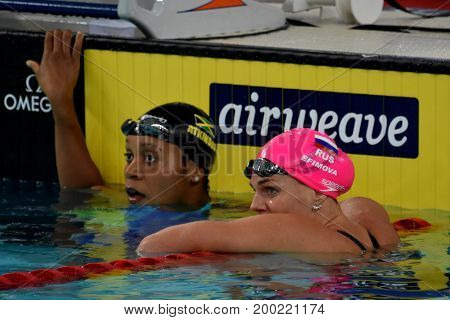 Hong Kong China - Oct 30 2016. ATKINSON Alia (JAM) and Yulia YEFIMOVA (RUS) after the Women's Breaststroke 50m Final. FINA Swimming World Cup Victoria Park Swimming Pool.