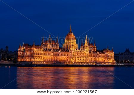Budapest Parliament building and Danube river at night with illumination, travel sightseeing background