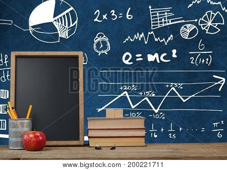 Digital composite of Desk foreground with blackboard graphics of math science diagrams