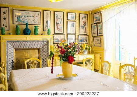 Giverny, France - 20 Oct 2016: inside the home of French impressionist painter Claude Monet's yellow dining room