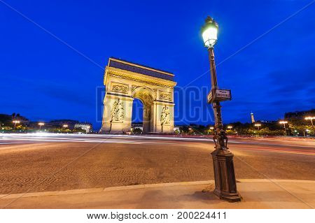 Place Charles de Gaulle at night with illuminated Arc de Triomphe, Paris, France