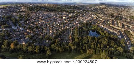 Editorial SWANSEA, UK - AUG 15, 2017: Brynmill Park in Swansea and the surrounding rural living areas of Brynmill, The Uplands and Townhill with the Brecon Beacons in the distance.