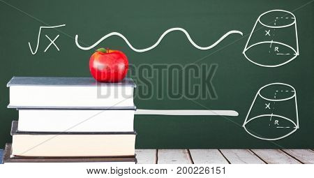Digital composite of Books on the table against green blackboard with education and school graphics