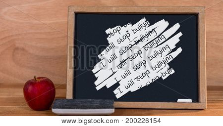 Digital composite of i will stop bullying on blackboard
