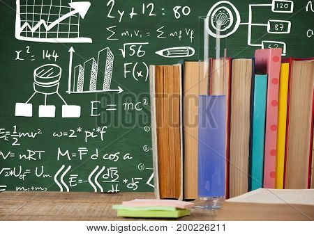 Digital composite of Science books and test tube on Desk foreground with blackboard graphics of science formulas