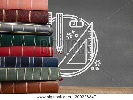 Digital composite of Books on the table against grey blackboard with education and school graphics