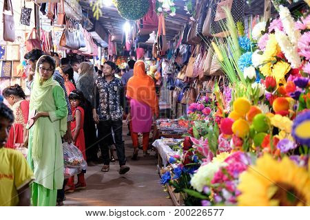 Dhaka, bangladesh, august 2017- group of people come whole sell flower market to buy flower for weddings event on evey friday located at shavar in dhaka in bangladesh taken on 17 august, 2017.