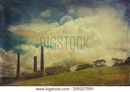 Dramatic blue cloud filled sky over the historic abandoned Bedford brick works chimneys in Sydney Park, St Peters, NSW, Australia. Grunge, vintage textured digital photo manipulation.