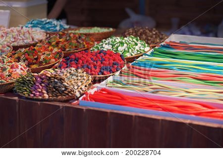 Colorful Candies and Sweets Stand at Night