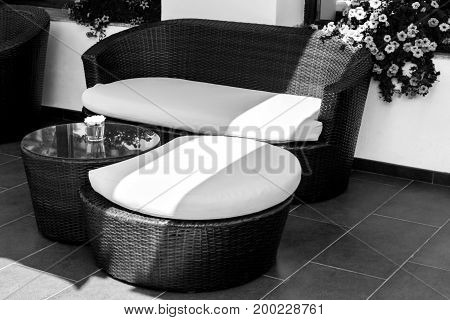 Wicker furniture in lounge area for relax at day in black and white