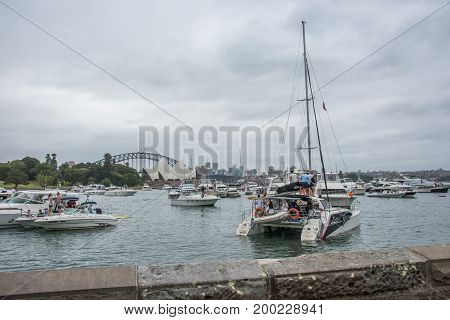 SYDNEY,NSW,AUSTRALIA-NOVEMBER 19,2016: Group of yachts and nautical vessels in farm cove for The Plot 2016 music festival with Opera House and Harbour Bridge in Sydney, Australia.