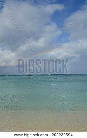 Rainbow in the sky over the beach in Aruba.