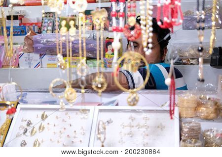 Dhaka, bangladesh, august 2017- shop owner indian man selling jewelry at his store located at shavar city center in dhaka in bangladesh taken on 17 august 2017.