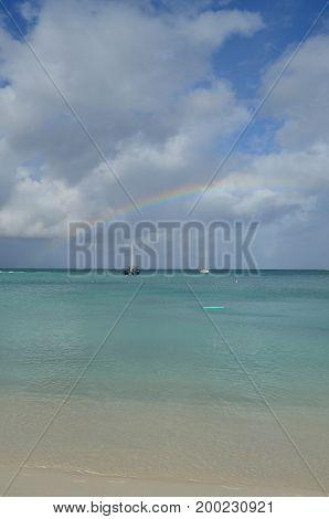 Bright colorful rainbow across the sky in Aruba.