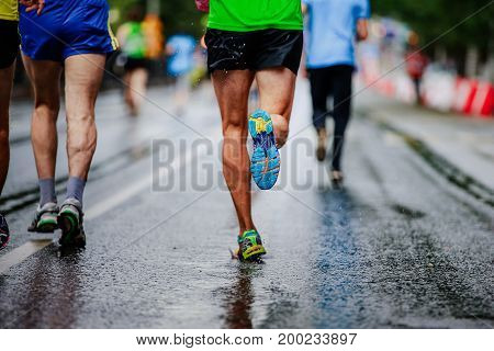 water drop in running shoe man runner running marathon