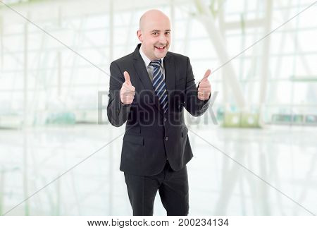 happy business man going thumb up, at the office
