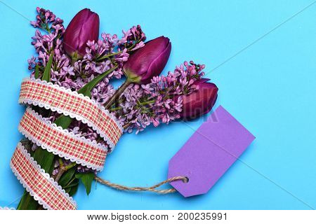 Purple Tulips And Lilac Flowers With Ribbon And Violet Card