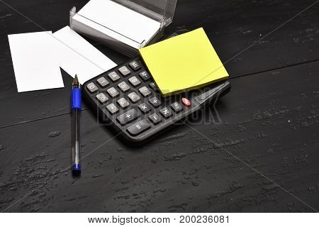 Business And Work Concept: Stationery On Black Wooden Background