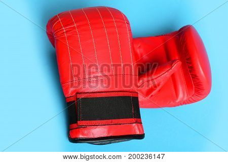 Boxing Gloves Isolated On Bright Blue Background. Sports Concept