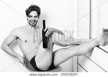 Caucasian Bearded Sexy Macho Holding Bottle