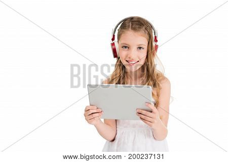 Child In Headphones With Tablet