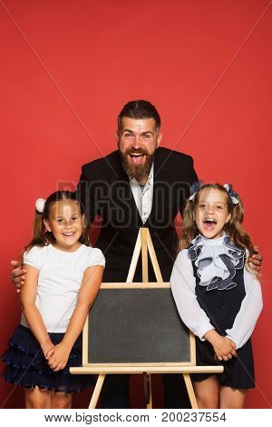 Studying And Back To School Concept. Kids Stand Near Blackboard