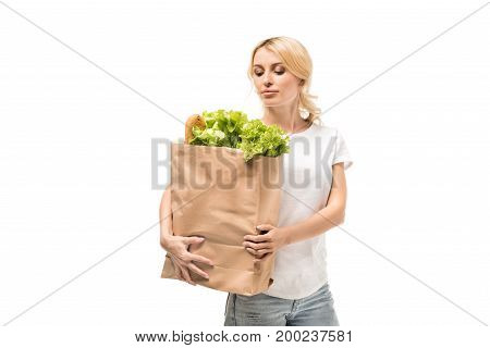 portrait of young woman looking at paper bag in hands isolated on white