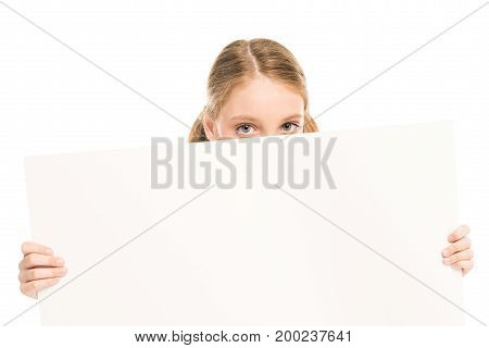 obscured view of little girl holding blank banner in hands isolated on white
