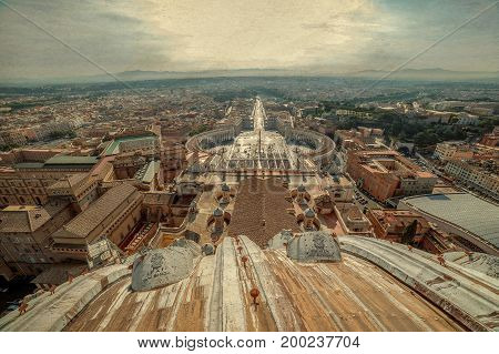 Old photo with aerial view from the cupola of Papal Basilica over St. Peter's Square in the Vatican City. Rome Italy.