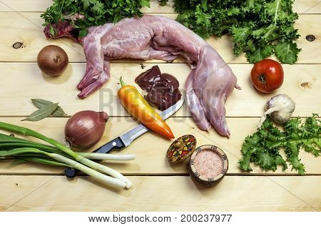 Preparation for cooking rabbit with vegetables closeup