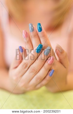 beautiful blue fingernail manicure acrylic nail polish of woman hand beauty fashion poster