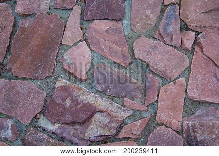 Granite stones pavement close-up. Backgrounds and textures