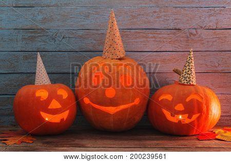 the halloween pumpkin on blue wooden background