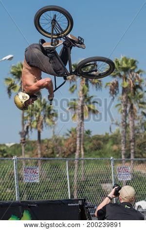 Bmx Rider Making A Bike Jump During Dub Show Tour