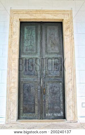 A large entryway with ornate metal doors