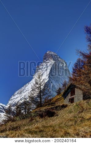 The peak of the Matterhorn in Switzerland with a Hofstetten in the foreground.