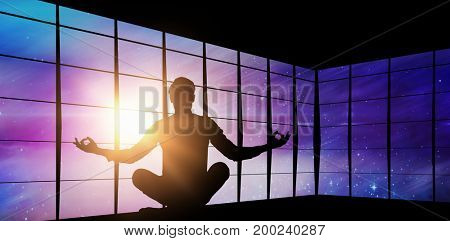 Zen businessman meditating in yoga pose against view of empty space Zen businessman meditating in yoga pose on white background