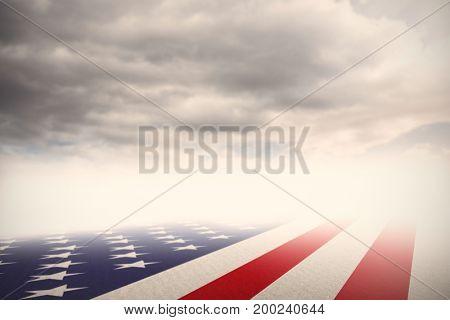 Usa national flag against cloudy sky