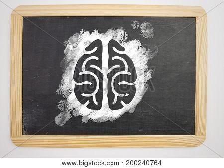 Digital composite of brain icon on blackboard