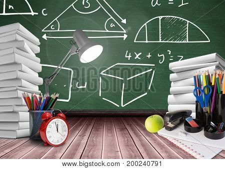 Digital composite of Lamp on Desk foreground with blackboard graphics of math diagrams