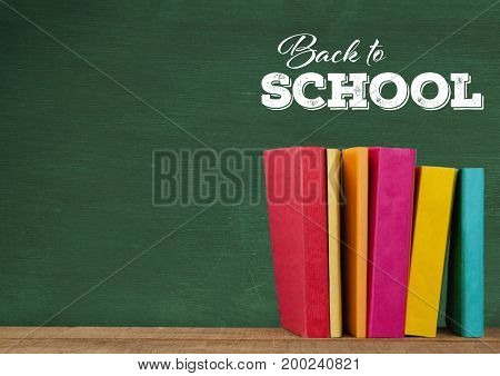 Digital composite of Back to school text on blackboard and Desk with books
