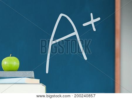 Digital composite of A+ grade with chalk and apple